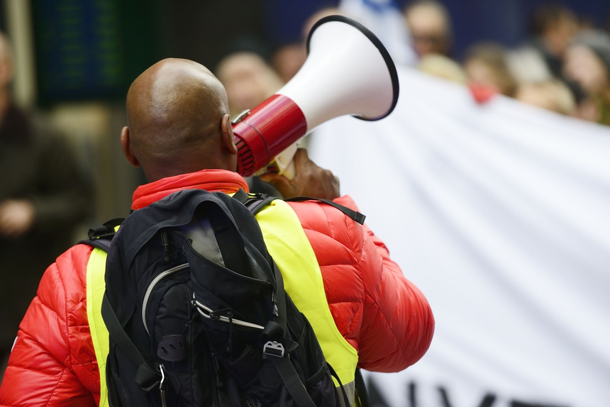 an activist with megaphone on the protest action