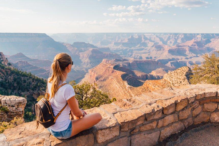 Beautiful girl exploring Grand Canyon village in Arizona, USA.