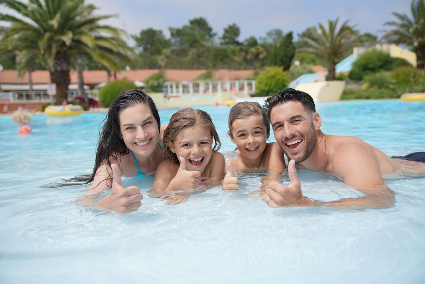 Cheerful family in hotel swimming-pool
