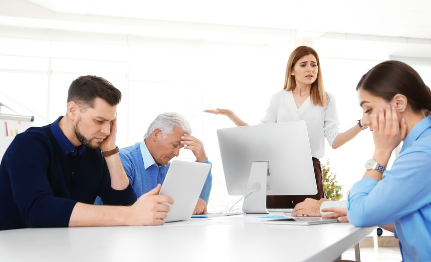 Office employees having argument during business meeting