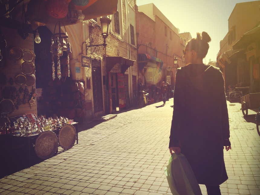 Young woman shopping in the Marrakech Medina at sunset