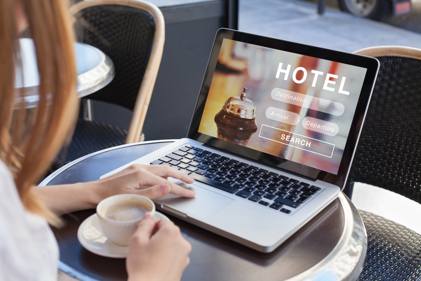 booking hotel on internet, travel planning, online reservation concept, woman looking at screen of computer searching  accommodation