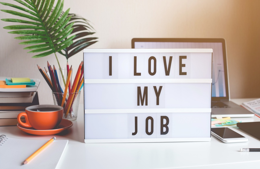 I love my job concepts with text on light box on desk table in home office