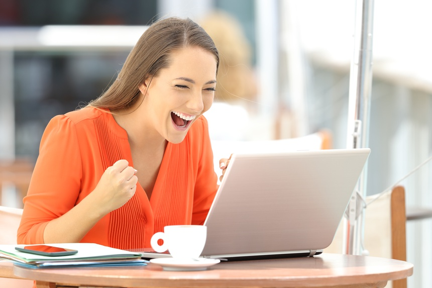 Excited entrepreneur receiving good news on line