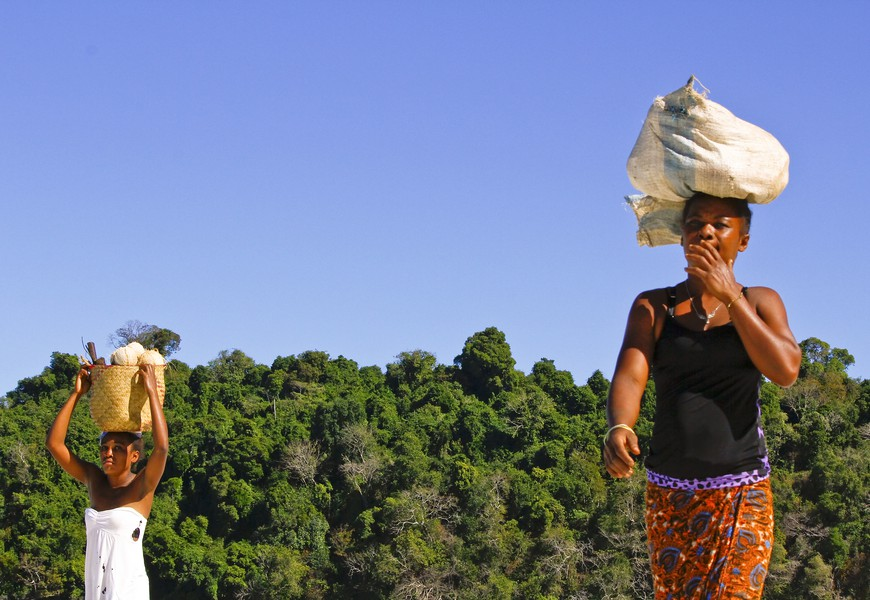Malagasy woman carrying cargo on head