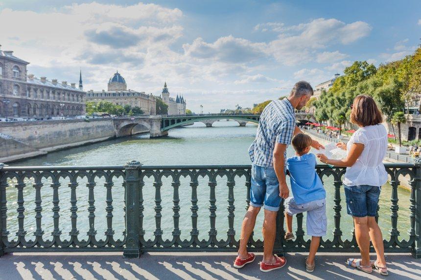 Happy family of three enjoying vacation in Paris, France