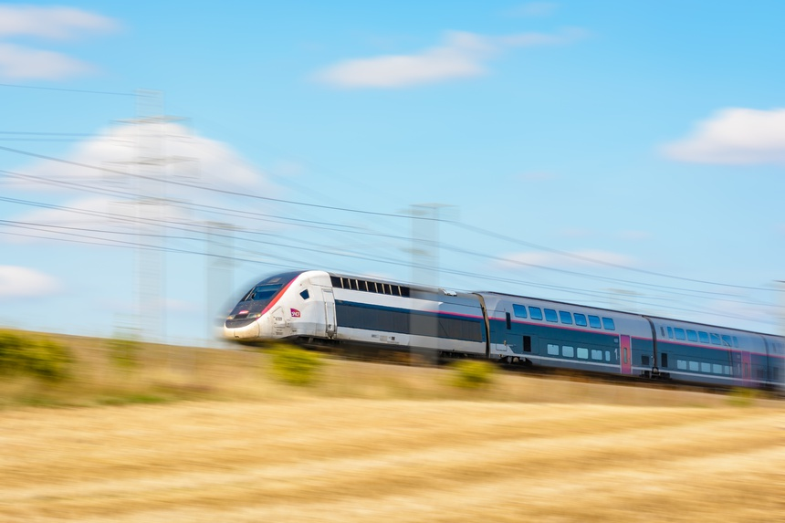 Varreddes, France - August 18, 2018: A TGV Duplex high-speed train in Carmillon livery from french company SNCF driving at full speed on the East European high-speed line (artist's impression).