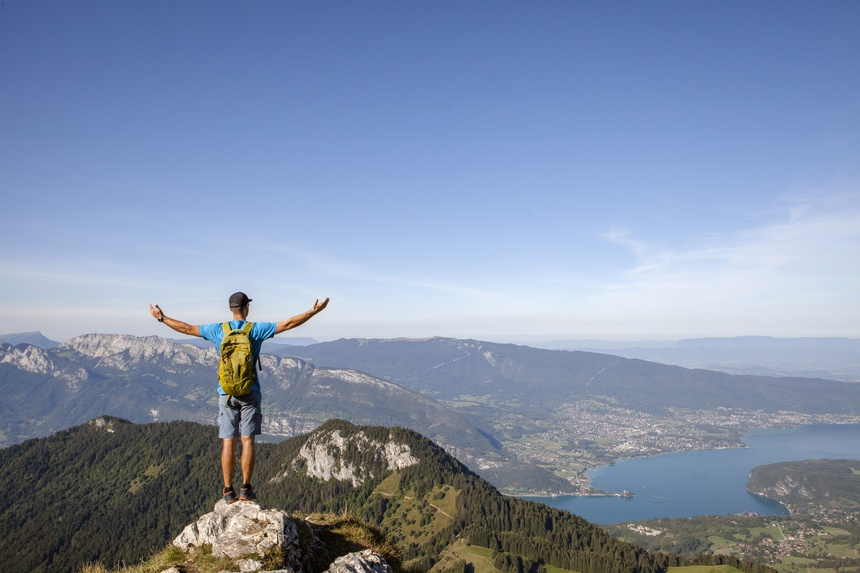 Happy hiker full of freedom and happiness, winning reaching life goal, achievement in mountains and success in life. Exploring new summits and adventures. La Tournette, Annecy, France