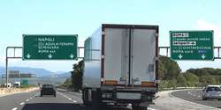 junction motorway with truck and italian traffic signal