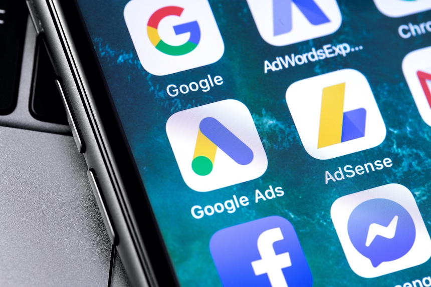 closeup keyboard laptop and Google Ads AdWords app icon on smartphone screen. Google is the biggest Internet search engine in the world. Moscow, Russia - April 27, 2019