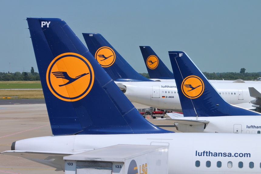 DUSSELDORF, GERMANY - JULY 8: Multiple Lufthansa aircraft wait on July 8, 2013 in Dusseldorf Airport, Germany. Lufthansa Group carried over 103 million passengers in 2012.