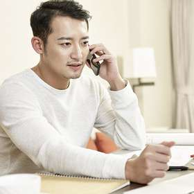 young asian businessman working from home