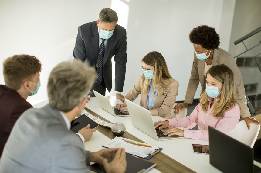 Group business people have a meeting and working in office and wear masks as protection from corona virus