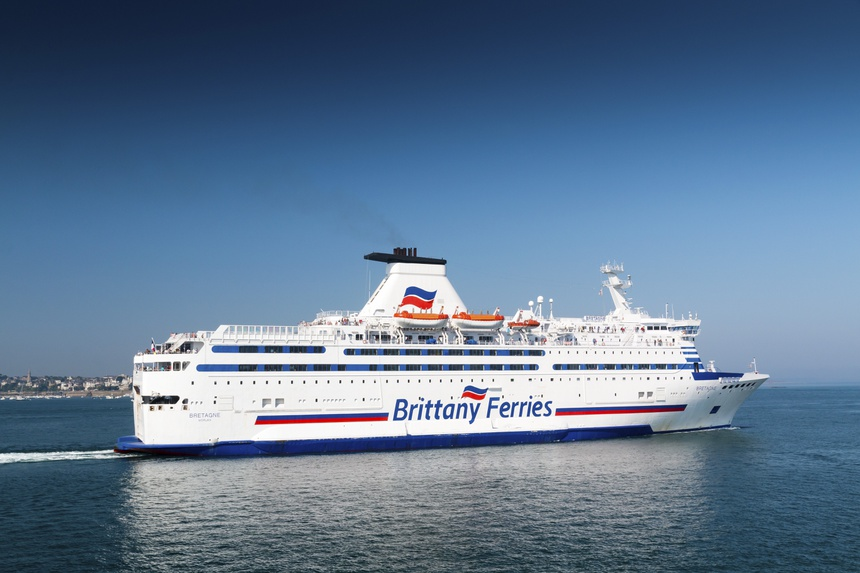 Saint Malo, Brittany, France - July 8, 2018: Brittany Ferries cross channel ferry Bretagne sailing from the port of Saint Malo on a hot summer day with a clear blue sky