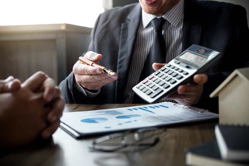 Real estate broker agent being analysis and making the decision a home estate loan to customer, Agent man is using calculator to presentation detail and waiting for his reply to finish