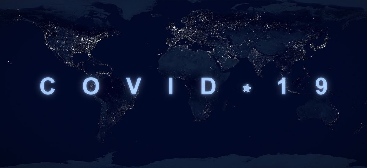 COVID-19 pandemic concept, name COVID on dark night planet map.