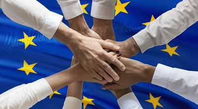 Multicultural hands union concept over european flag