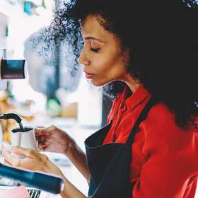 Side view of pensive african american female waitress in black a