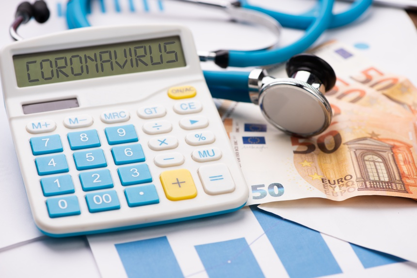 coronavirus epidemic and its financial consequences. A calculator with the word CORONAVIRUS