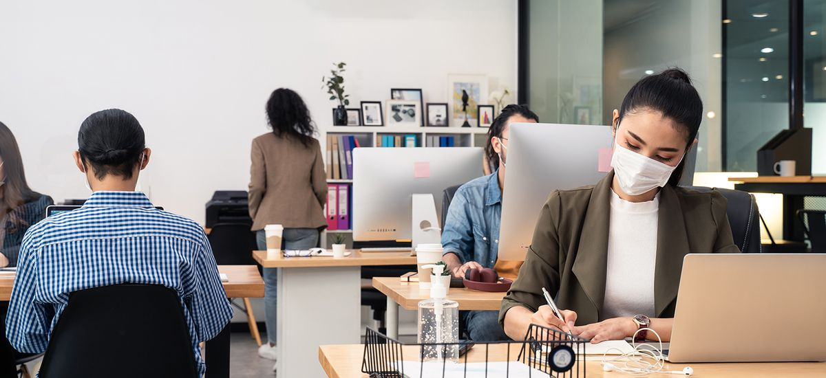 Asian business people working in office with new normal lifestyl