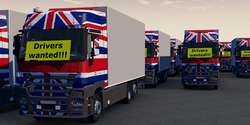 Trucks with a drivers wanted sign - Truck drivers shortage in th